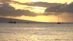 Lahaina Waterfront Golden Sunset on Ocean Stock Footage