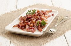 Grilled bacon bits on a plate Stock Photos