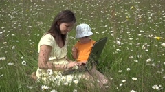 Stock Video Footage of Mother working to tablet in nature, little boy close tablet 4K