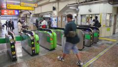 Passengers and ticket counter on train station during rush hour, Tokyo, Japan Stock Footage