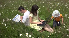 Stock Video Footage of Busy parents, tablet and book, child needs attention, spring field