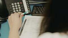 Girl at desk with a telephone in a call center Stock Footage