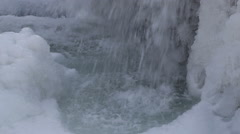 Ice waterfall in the rocks with lots of ice, movement of the camera Stock Footage