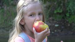 4K Portrait Little Girl Eating Apple Fruit, Child Relaxing River Mountains Trail Stock Footage