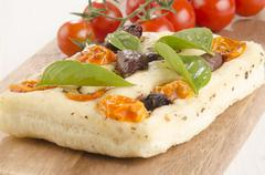 Mediterranean flat bread on wooden board Stock Photos