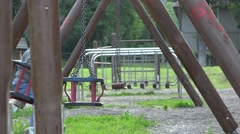 Baby child balancing in a swing 4K Stock Footage
