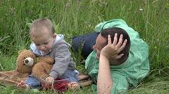 Stock Video Footage of Amusing baby child eat fresh fruit, child feeding father 4K