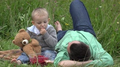Funny child eat tasty fruits and give to father in park 4k Stock Footage