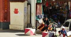 4k grocery store in Shangri-La street,Fruit stand & Minority women. Stock Footage