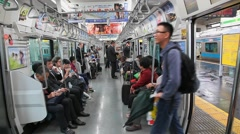 Passengers inside of train in subway, Tokyo, Japan Stock Footage