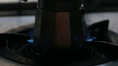 Gas fire at gas-stove with coffee-pot Stock Footage