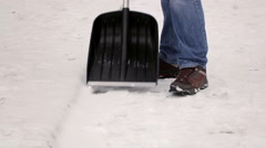 Man working with snow shovel Stock Footage