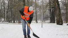 Worker working with snow shovel Stock Footage