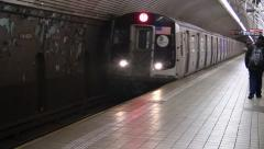 Stock Video Footage of MTA NYC M Train Entering Fifth Avenue 53rd Street Station