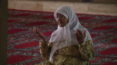 Old Woman Prays to Ask God Stock Footage