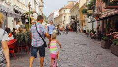 People with bicycles in Vilnius street in the old town of Kaunas, editorial  Stock Footage