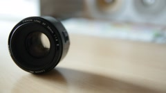 50mm dslr / slr photography lens on a desk Stock Footage