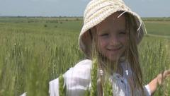 Stock Video Footage of Happy Portrait, Face Child in Wheat Field, Little Girl View Playing, Slow Motion