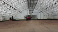Forestry tractors Greenhouses are two lifts Stock Footage