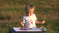 Stock Video Footage of Amusing baby boy painting in the park 4k