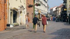 Relaxed people in Vilnius street in the old town of Kaunas, editorial  Stock Footage
