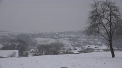 ULTRA HD 4K Panoramic view rural village blizzard winter day mountain hill place Stock Footage
