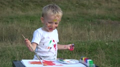 Stock Video Footage of Lovely child and mother hand painting in nature 4k