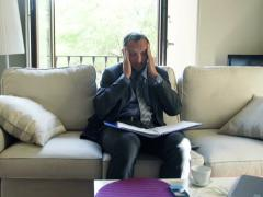Tired businessman having headache during work at home NTSC Stock Footage