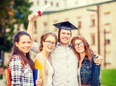 students or teenagers with files and diploma - stock photo