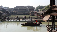 Pleasure boat on the canal in Wuzhen Stock Footage