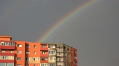 Rainbow over block of flats in a poor town, hope arise 4k - stock footage