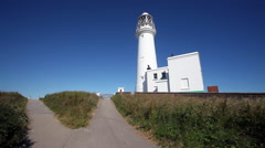 FLAMBOROUGH LIGHTHOUSE, FLAMBOROUGH HEAD, EAST YORKSHIRE, ENGLAND Stock Footage
