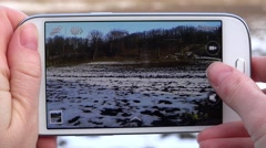 ULTRA HD 4K Woman hand take photo mobile phone smartphone rural orchard winter  Stock Footage