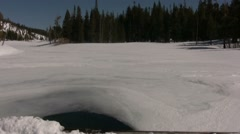 Lake Mary frozen over in the High Sierra Stock Footage