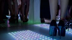 Dancing women legs  at the Disco Lights floor 2 Stock Footage