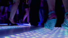 Women on a night party. Legs of dancing women  at the Disco Lights floor 2 3 Stock Footage