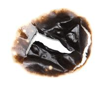 Burnt hole in a paper Stock Photos