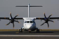 Plane taxi after landing Stock Photos