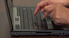 Close up of hands using a keyboard computer  Stock Footage