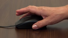 Close up of hands using computer mouse  Stock Footage