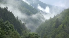 Gorgeous mountain landscape with clouds rising up Stock Footage