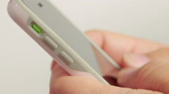 Texting and typing on iPhone smart phone cellphone - stock footage