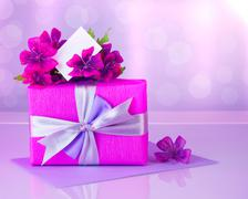 pink gift box with greeting card - stock photo