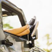 Woman keeping legs outside car Stock Photos