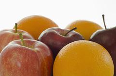 Studio shot of apples and oranges Stock Photos