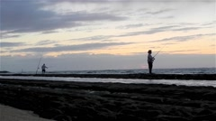 Two Fishermen on Beach at Sunrise Stock Footage