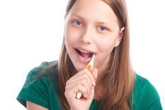 Happy teen girl with toothbrush Stock Photos