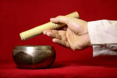 Tibetan singing bowl on the red background Stock Photos
