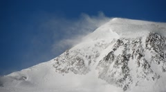 Strong wind over glacial mountain ridge Stock Footage
