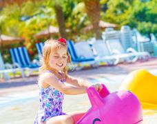 baby girl in aquapark - stock photo